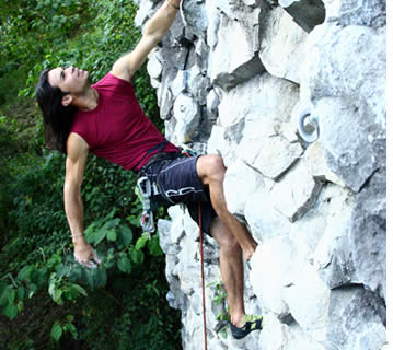 César Meléndez climbing a section of the Gunko Wall at Los Ladrillos in Boquete, Panama